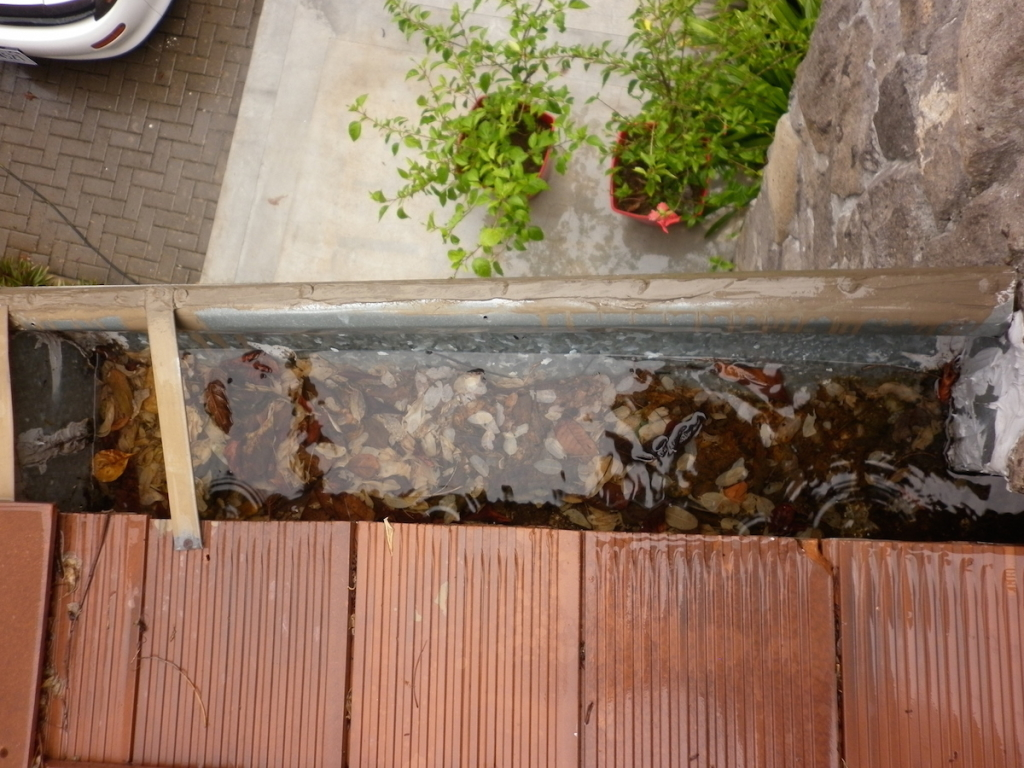 Clogged gutter - water has nowhere to go, before you know it, it's inside your home